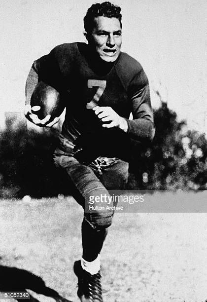 American football player Don Hutson runs with a ball 1940s Hutson played in 11 seasons with the Green Bay Packers and retired with more than 18...