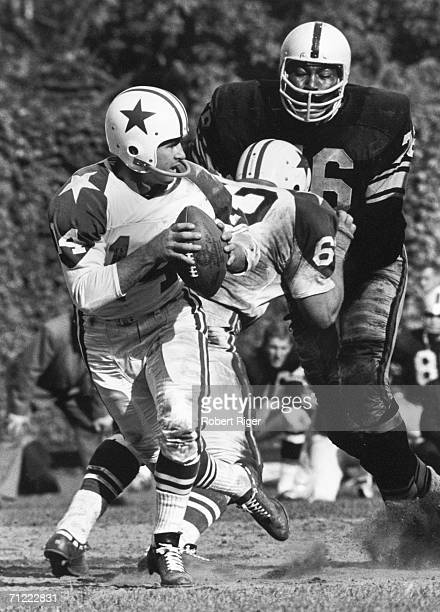 American football player Gene 'Big Daddy' Lipscomb defensive tackle for the Pittsburgh Steelers goes after a sack on Dallas Cowboys quarterback Eddie...