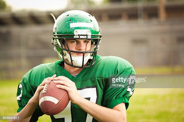 american football player, high school quarterback ready to throw pass - high school football stock pictures, royalty-free photos & images
