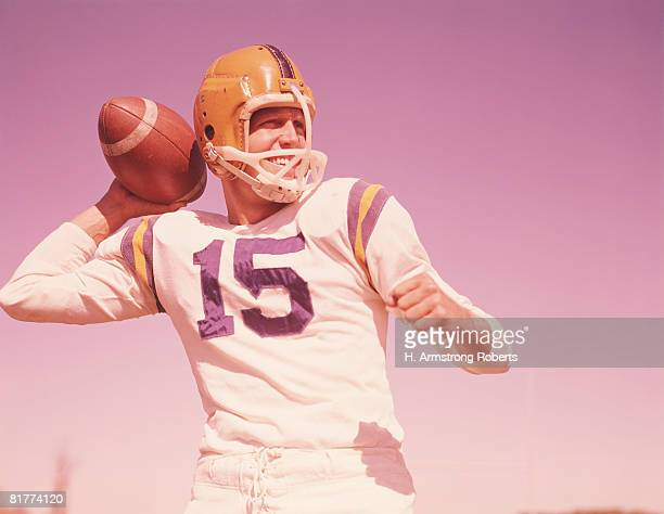 American football player, holding football, ready to throw. (Photo by H. Armstrong Roberts/Retrofile/Getty Images)