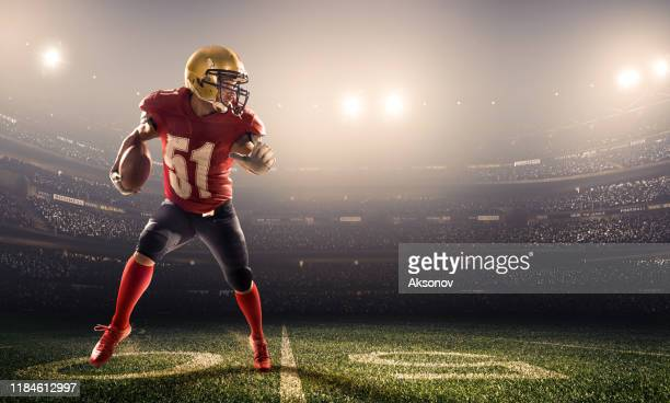 american football player in action - football player stock pictures, royalty-free photos & images
