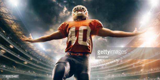 american football player in action - quarterback stock pictures, royalty-free photos & images