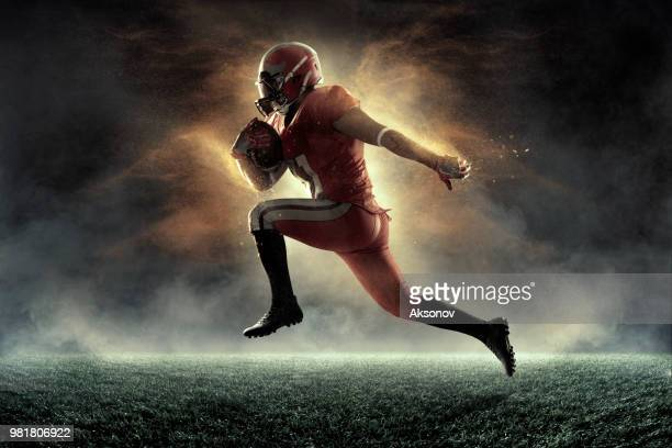 american football player in professional sport stadium - american football pitch stock pictures, royalty-free photos & images
