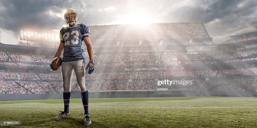 American Football Player in Sunlit Stadium : Stock Photo