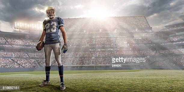 american football player in sunlit stadium - football player stock pictures, royalty-free photos & images