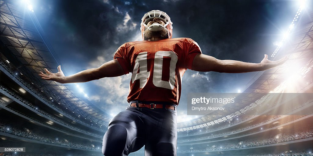 American football player is celebrating : Stock Photo
