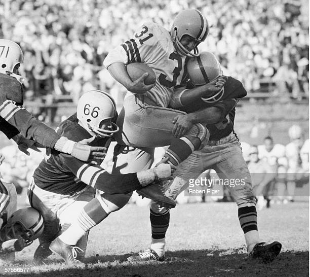 American football player Jim Taylor of the Green Bay Packers runs to runs past the Pittsburgh Steelers defensive line during a game late 1950s or...