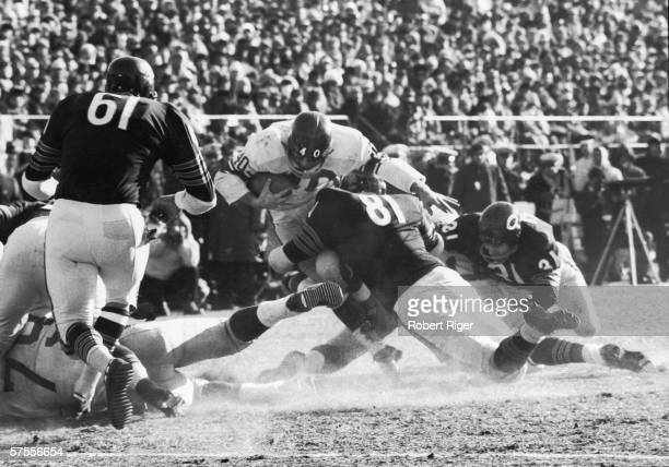 American football player Joe Morrison of the New York Giants is stopped by Doug Atkins of the Chicago Bears during the NFL Championship game Chicago...