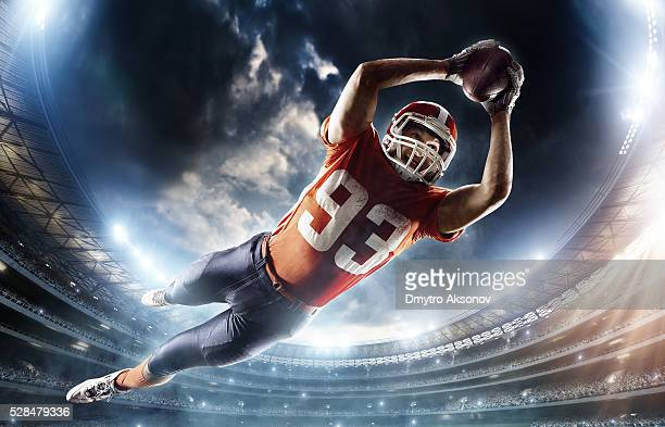 american football player jumping - wide receiver athlete stock pictures, royalty-free photos & images