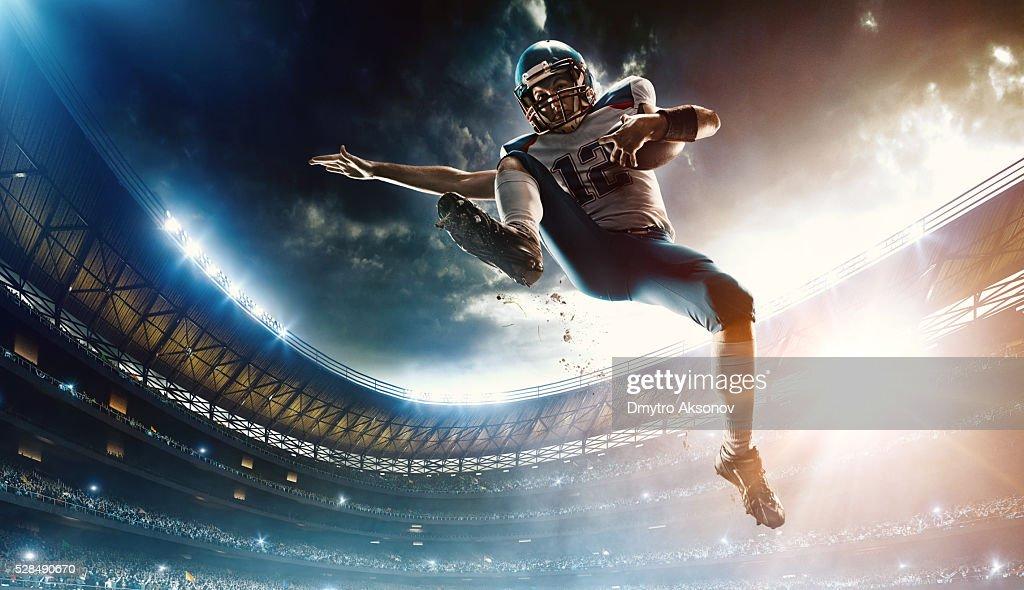 American football player jumping : Stock Photo