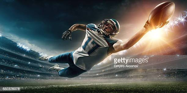 American football player jumping