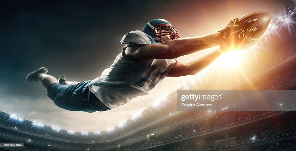 American football player jumping : Stock Photo