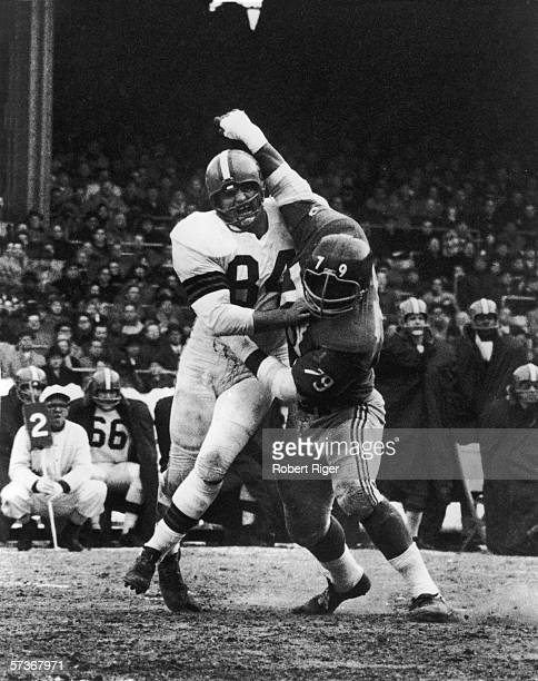 American football player Paul Wiggen defensive end for the Cleveland Browns fights off Roosevelt Brown tackle for the New York Giants during a game...