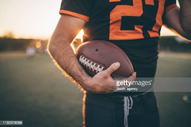 american football player - american football strip stock pictures, royalty-free photos & images