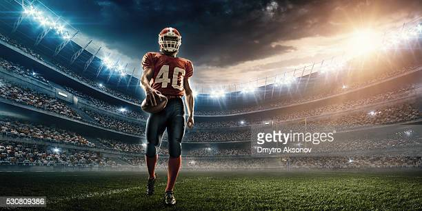 american football player - american culture stock pictures, royalty-free photos & images
