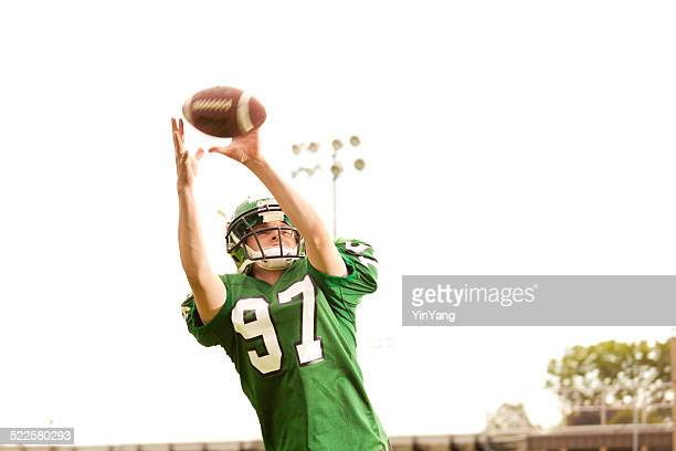 american football player receiver in action - wide receiver athlete stock pictures, royalty-free photos & images