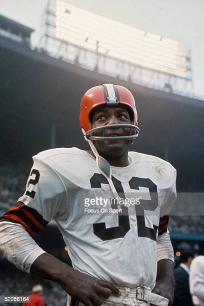 American football player, running back Jim Brown, #32 of the Cleveland Browns, stands on the field during a game. Jim Brown played for the Browns...