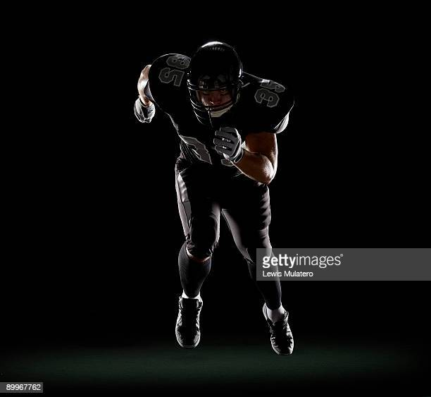 american football player running - american football player stock pictures, royalty-free photos & images