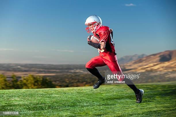jugador de fútbol americano en funcionamiento la pelota - rush fútbol americano fotografías e imágenes de stock