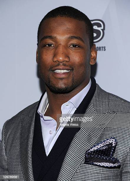 American football player Shaun Phillips arrives at the AfterSchool All Stars Hoop Heroes Salute launch party at Katsuya LA Live on February 18 2011...