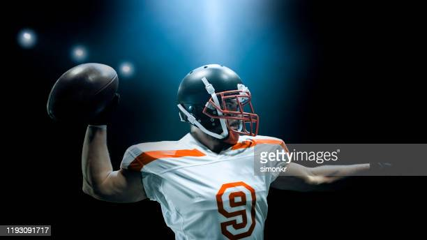 american football player throwing ball - quarterback stock pictures, royalty-free photos & images
