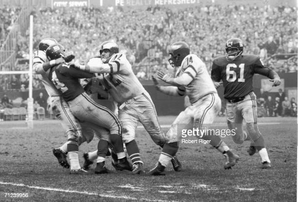 American football player YA Tittle of the New York Giants gets into trouble with the defensive line of the Philadephia Eagles early 1960s