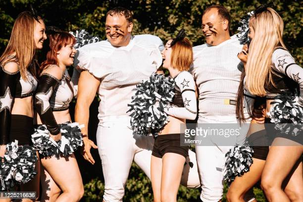 american football players and cheerleader girls having fun - american football team stock pictures, royalty-free photos & images