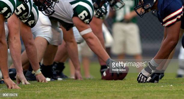 american football players at american football game - quarterback stock photos and pictures
