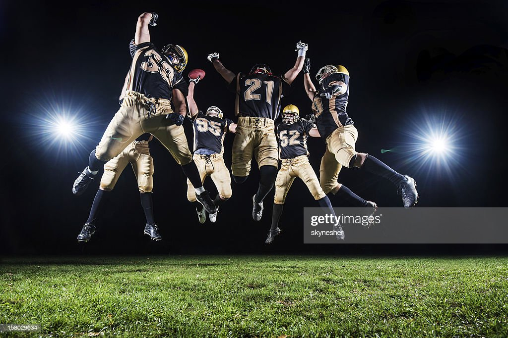 American Football Players celebrating their victory. : Stock Photo