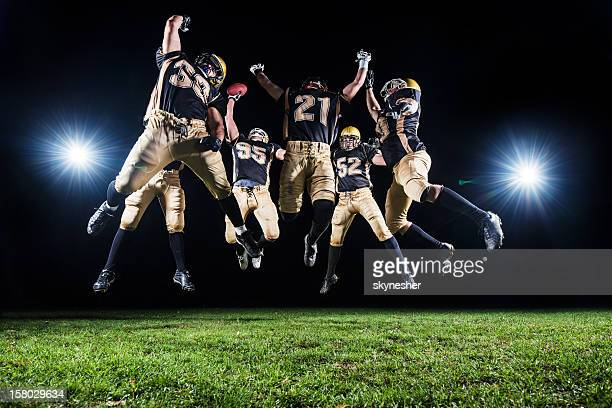 american football players celebrating their victory. - football league stock pictures, royalty-free photos & images