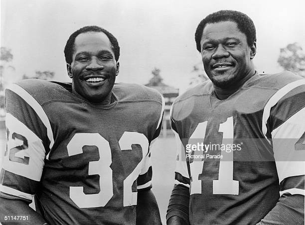 American football players Emerson Boozer and Matt Snell pose in their New York Jets uniforms, late 1960s.