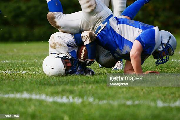 american football players falling - personal injury stock photos and pictures