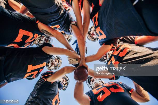 american football players huddling - scrum stock pictures, royalty-free photos & images
