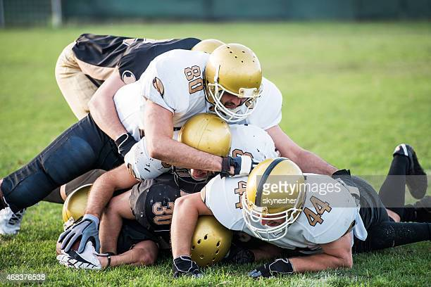 american football players in action on the playing field. - tackling stock pictures, royalty-free photos & images
