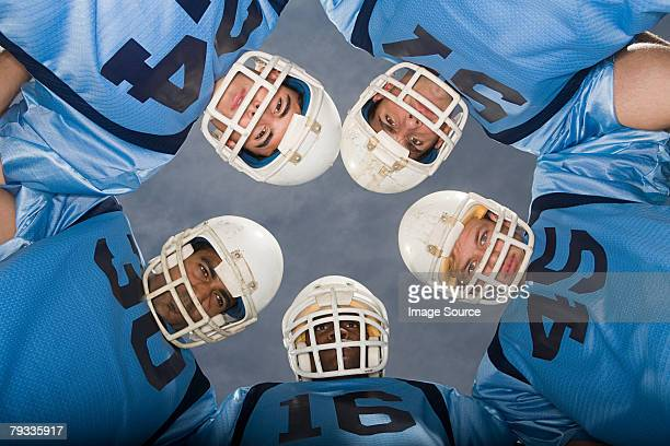 american football players in huddle - safety american football player stock pictures, royalty-free photos & images