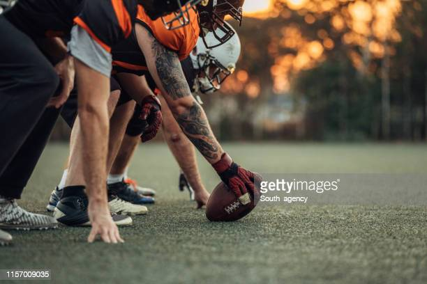 american football players on a beginning of the match - quarterback stock pictures, royalty-free photos & images