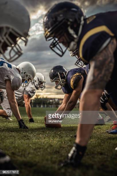 american football players on a beginning of the match. - face off sports play stock photos and pictures