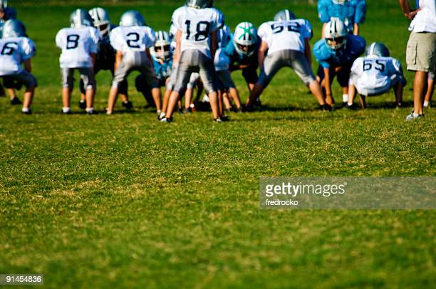 American Football Players on Football Field at Football Game