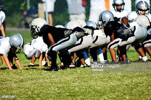 american football players on football field at football game - football league stock pictures, royalty-free photos & images