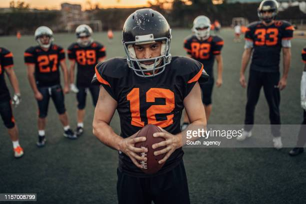 american football players portrait - american football strip stock pictures, royalty-free photos & images