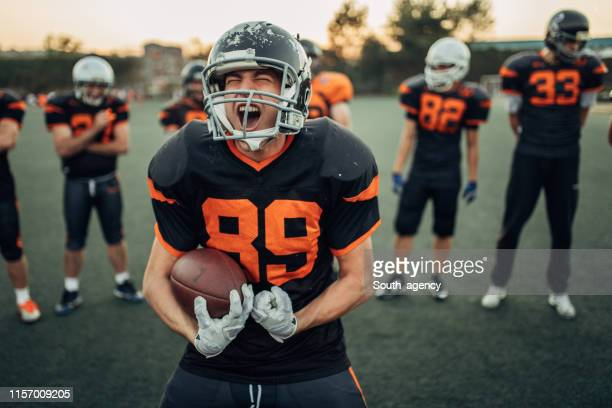 american football players portrait - touchdown stock pictures, royalty-free photos & images