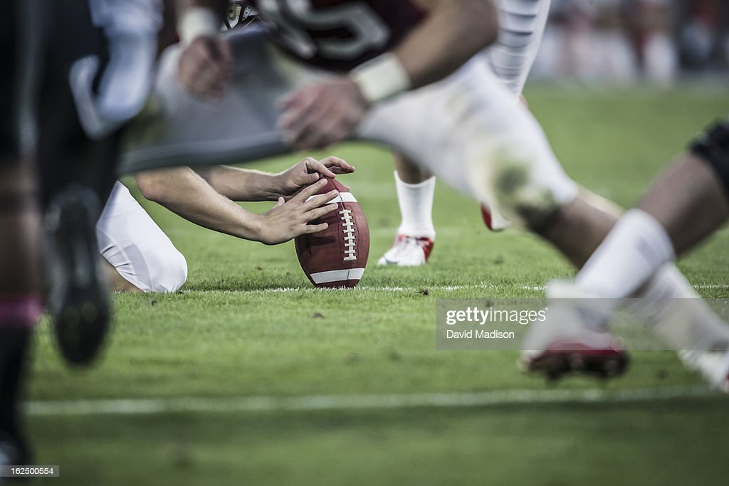 American football players readying to kick ball. : Stock Photo