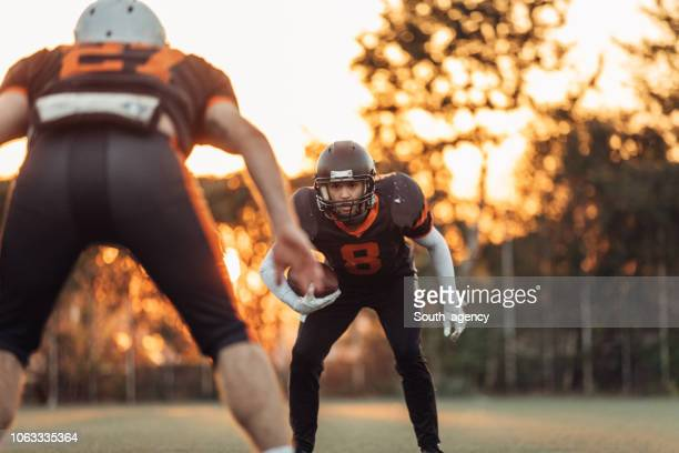 american football practice outdoors - guard american football player stock photos and pictures