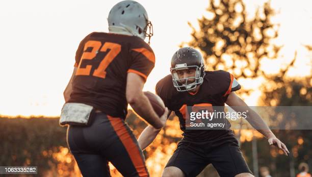 american football practice - guarding stock photos and pictures