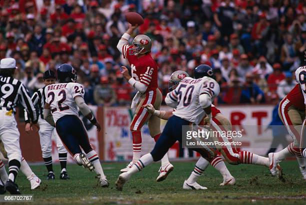 American football quarterback Joe Montana pictured in action with the ball playing for the San Francisco 49ers against the Chicago Bears at...