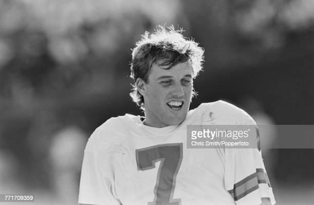 American football quarterback John Elway pictured in action for Denver Broncos against Los Angeles Raiders at Los Angeles Memorial Coliseum on 3rd...