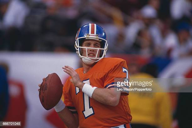 American football quarterback John Elway, pictured in action playing for the Denver Broncos against the Washington Redskins during Super Bowl XXII at...