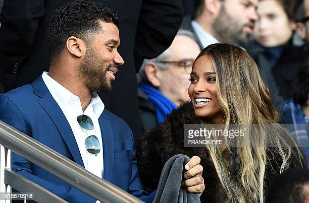 US American football quarterback of the Seattle Seahawks Russell Wilson and his gilfriend US singer Ciara attend the French L1 football match between...