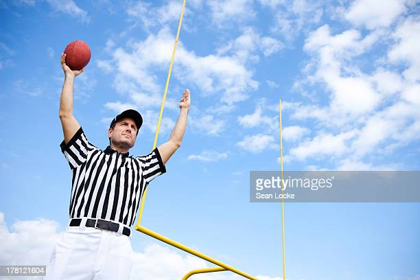 American Football Referee: Holding Touchdown Ball