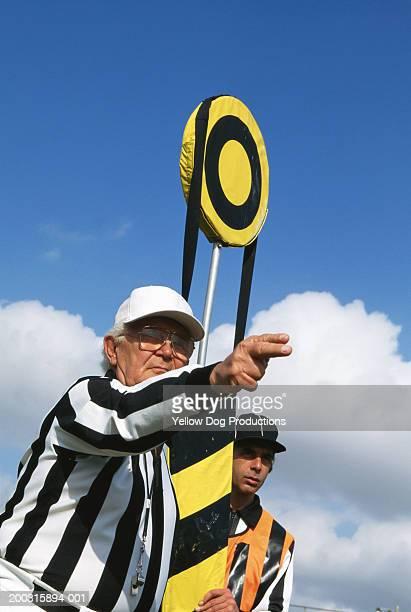 American football referee signaling